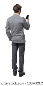 Back view of a businessman who is looking into the smartphone.  Isolated over white background. backside view of person. A young businessman in a tweed suit reads from a phone screen.