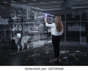 Back view of businesswoman working with virtual panel