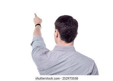 Back view of casual man pointing at copy space