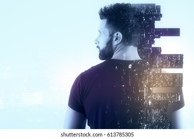 Back view of casual young man on city background. Employment concept. Double exposure