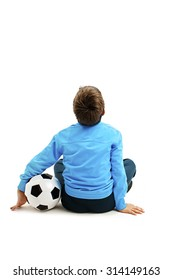Back view of a child in sportswear with soccer ball. Isolated on white background