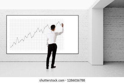Back view concept of businessman drawing chart on wall