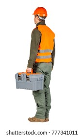 a back view of construction worker in a helmet with toolbox and looking forward over white wall background. repair, construction, building, people and maintenance concept.