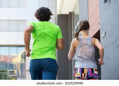 Back view at couple running outdoor