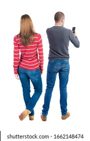 Back view of couple in sweater with mobile phone. Rear view people collection. backside view of person. Isolated over white background.