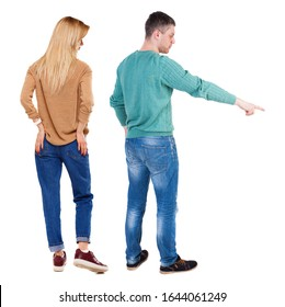 Back view of couple couple in sweater pointing. beautiful friendly girl and guy together. Rear view people collection. backside view of person. Isolated over white background.