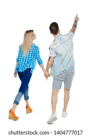 Back view of the couple walking and pointing upwards. Rear view people collection. backside view of person. Isolated over white background. Stylish couple on the go considering the sights.