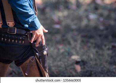back view of cowboy with gun prepares to gun fight.cowboy with gun.