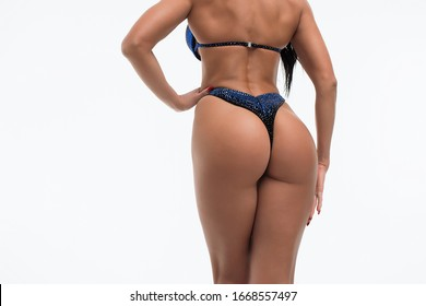Back view of crop sexual woman with perfect body in blue bikini isolated on white background