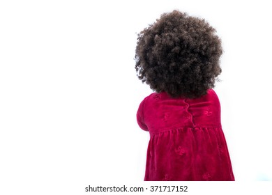 Back view of cute African girl child, studio shot