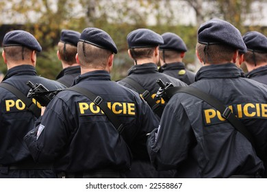 Back view of Czech police forces armed with sub-machine guns