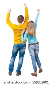 Back view of dancing young couple(men and women). Dance party. girls and guys teens dance, enjoy and express positive emotions and having fun. backside view of person.