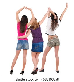 Back view of dancing young women. Dance party. girls dance, enjoy and express positive emotions and having fun.  Rear view. Isolated over white.