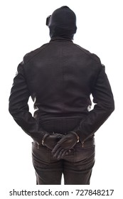 Back view dangerous criminal wearing black clothes and mask with handcuffs on isolated background