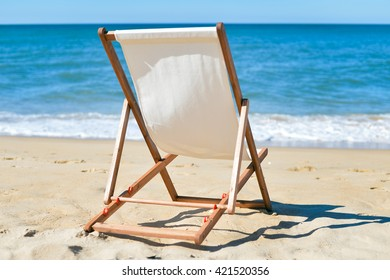 Back View Of Deckchair On Sandy Beach Vacation