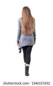 Back view of elegant young woman with long dark blonde hair walking away leaving. Full body isolated on white background.