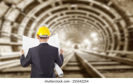 Safety hand rail images stock photos vectors 10 off shutterstock back view engineer hand holding yellow helmet for workers security and blueprint paper plan against the malvernweather Images