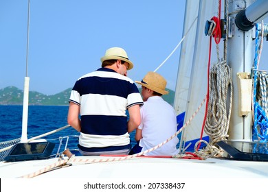 Back view of father and son sailing on a luxury yacht or catamaran boat
