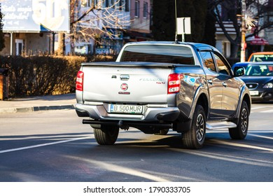 Back view of Fiat Fullback in traffic on the streets in Bucharest, Romania, 2020