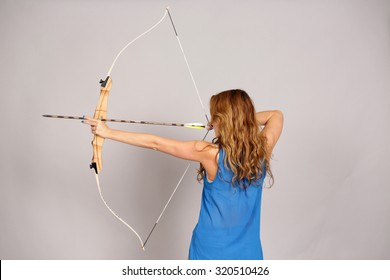 back view of girl with bow and arrow