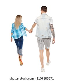 Back view of going couple. walking friendly girl and guy holding hands. Rear view people collection. backside view of person. Isolated over white. A happy couple is running around holding hands.