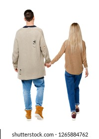 Back view of going couple. walking friendly girl and guy holding hands.  backside view of person. Isolated over white background. Husband and wife walking slowly holding hands.