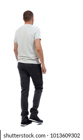 Back view of going  handsome man. walking young guy . Rear view people collection.  backside view of person.  Isolated over white background. A guy in a white T-shirt and trousers pass by.