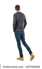 Back view of going  handsome man. walking young guy. Rear view people collection. backside view of person.  Isolated over white background. A thin guy in a jacket slowly walks by