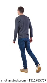 Back view of going  handsome man . walking young guy . Rear view people collection.  backside view of person.  Isolated over white background. a man in a gray sweater walks by