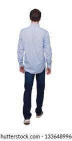 Back view of going  handsome man . walking young guy . Rear view people collection.  backside view of person.  Isolated over white background. The guy in the long shirt goes forward slowly.