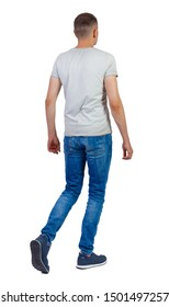 Back view of going  handsome man . walking young guy . Rear view people collection.  backside view of person.  Isolated over white background. A guy in a gray T-shirt slowly walks past.