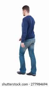 Back view of going  handsome man. walking young guy . Rear view people collection.  backside view of person.  Isolated over white background.  guy in jeans goes to the right.