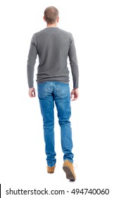 Back view of going  handsome man. walking young guy . Rear view people collection.  backside view of person.  Isolated over white background. A guy in a gray sweater goes away.