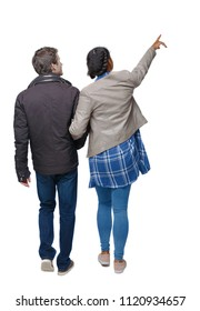 Back view of going interracial couple. walking friendly girl and guy holding hands. Rear view people collection. backside view of person.  A couple in warm clothes on a stroll and sees sights