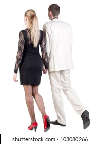 Back view of going young business couple (man and woman).  walking beautiful friendly girl in dress, guy in suit. Rear view people collection.  backside view  person.  Isolated over white background