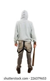 Back view of a  guy holding a baseball bat symbolizing crime. Isolated on white background