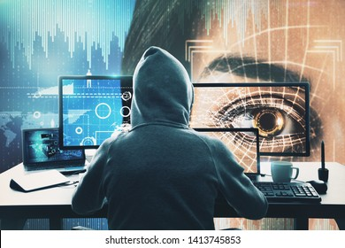 Back view of hacker at desk using computers and hacking face recognition system. Hack and criminal concept. Double exposure