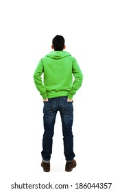 Back view of handsome with both hands in his pockets looking up. Standing young guy. Rear view people collection. backside view of person. Isolated over white background.