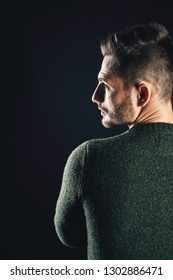 Back view of handsome man in dark background. face profile portrait