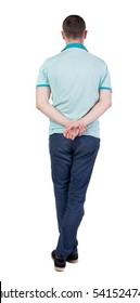 Back view of handsome man in polo looking up.   Standing young guy in jeans. Rear view people collection.  backside view of person.  Isolated over white background.