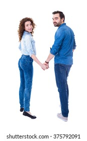 back view of happy couple standing isolated on white background
