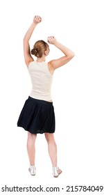 Back view joyful woman celebrating victory hands up. Rear view people collection. backside view person. Isolated over white background. slender blonde in a dress shows symbol of success or hitchhiking