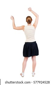 Back view of  joyful woman celebrating victory hands up. Rear view people collection. backside view of person. Isolated over white background. slender blonde in a dress shows symbol of success