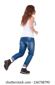 back view of jumping  woman  in  jeans. beautiful redhead girl in motion. girl running quickly. backside view of person.  Rear view people collection. Isolated over white background.