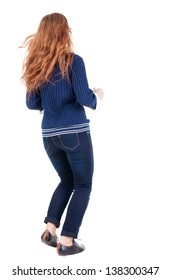 back view jumping woman in jeans. beautiful redhead girl in motion. girl running quickly. backside view person Rear view people collection. Isolated over white background.