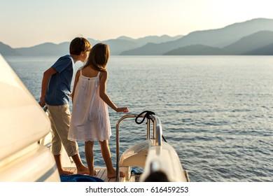 Back View of Kids Enjoying Sailing on a Luxury  Yacht