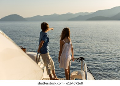 Back View of Kids Enjoying Sailing on a Luxury  Yacht