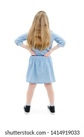 Back view of little girl looking at wall. Rear view. Isolated on white background