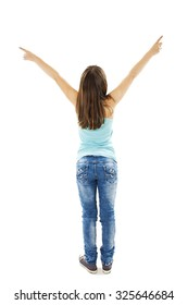 Back view of little girl points at wall with both hands. Rear view. Isolated on white background