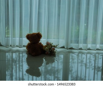 Back view of Lonely doll bears on chair with window light, Sadness concept in vintage color tone, Heartbreak.Teddy bear.